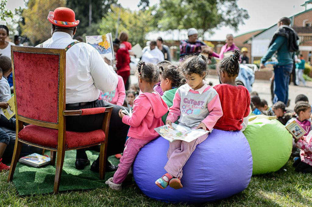 NT18MNlibraryChildren-enjoying-a-good-story-at-the-Readathon-pop-up-library.jpg